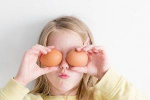 girl holding eggs