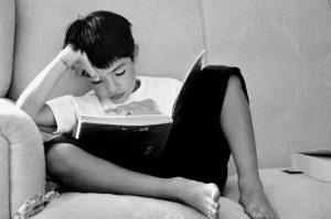 boy reading in summer