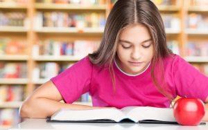 girl studying for literacy assessment
