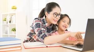 mother and daughter learning online